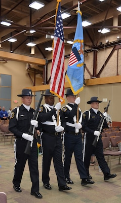 Defense Logistics Agency Installation Support at Richmond Police Honor Guard posts the colors during a ceremony May 11, 2017 honoring fallen law enforcement officers in the Frank B. Lotts Conference Center on Defense Supply Center Richmond, Virginia.