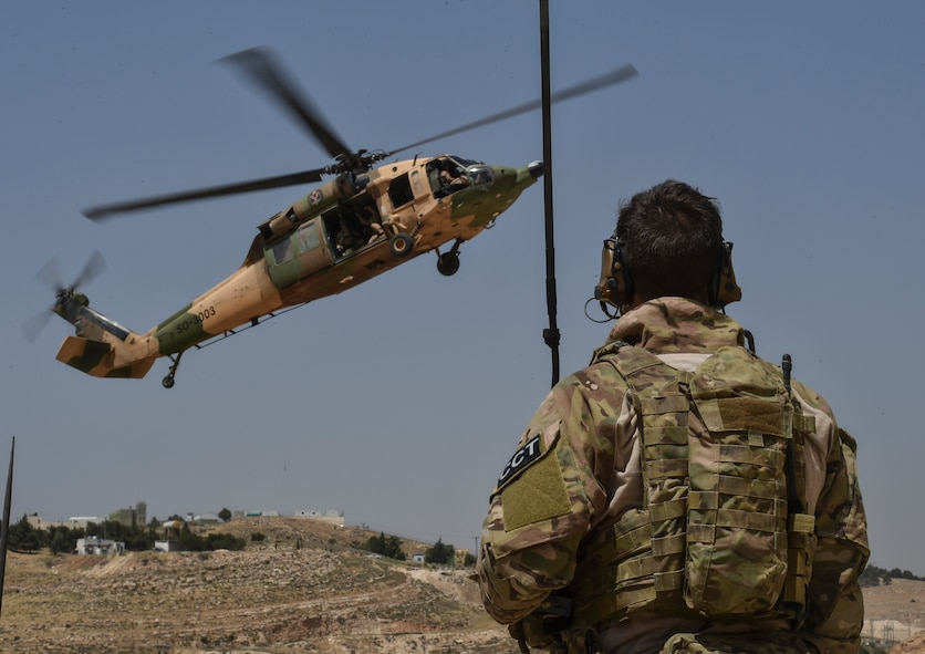 A U.S. Air Force Special Tactics Airman controls the approach of a Royal Jordanian Air Force UH-60L Blackhawk helicopter during Exercise Eager Lion for a personnel recovery training mission May 11, 2017, at King Abdullah II Special Operations Training Center. (U.S. Air Force photo/Senior Airman Ryan Conroy)