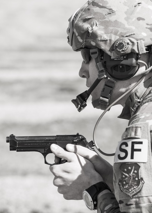 Tech. Sgt. Kyle Douglas, 91 Security Forces Group NCO in charge of physical security, prepares to fire an M9 pistol at Camp Grafton, N.D., May 4, 2017. The Global Strike Challenge team fired the M9 and M4 in a variety of positions and situations to prepare for the competition. (U.S. Air Force photo/Senior Airman J.T. Armstrong)