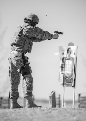 Airman 1st Class Ryan Benjamin, 91st Missile Security Forces Squadron response force member, fires an M9 pistol at Camp Grafton, N.D., May 4, 2017. Defenders combined physical training and weapons firing to prepare for Global Strike Challenge 2017. (U.S. Air Force photo/Senior Airman J.T. Armstrong)