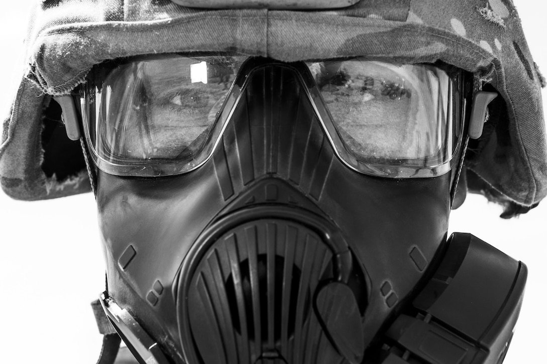 Airman 1st Class Ryan Benjamin, 91st Missile Security Forces Squadron response force member, prepares for Global Strike Challenge training at Camp Grafton, N.D., May 4, 2017. Benjamin, also a 91st SFG Global Strike Challenge team member, used the gas mask to control breathing during the physical training. (U.S. Air Force photo/Senior Airman J.T. Armstrong)