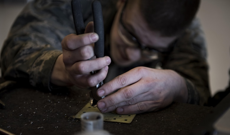 Airman 1st Class Kevin McGeary, 92nd Maintenance Squadron aircraft structural maintenance journeyman, conducts a drain screw nut plate replacement on a non-flush patch May 10, 2017, Fairchild Air Force Base, Wash. Corrosion can occur on a KC-135 Stratotanker if paint gets chipped off in bad weather or if a rock hits an aircraft hard enough to cause damage to the paint exposing the metal. (U.S. Air Force Photo/Airman 1st Class Sean Campbell)