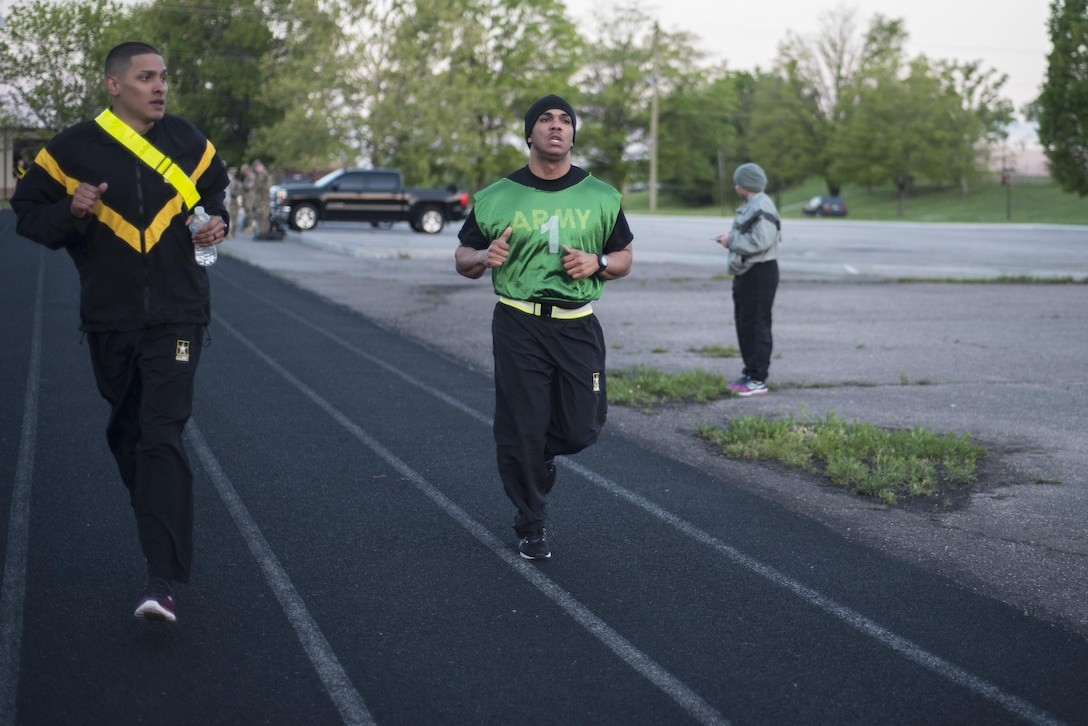 Sgt. 1st Class Francis Reyes, 2017 U.S. Army Human Resources Command Noncommissioned Officer of the Year, completes lap 6 of eight during the 2-mile run event in the APFT portion of the HRC Best Warrior Competition held at Fort Knox, Ky., May 8-11, 2017. Reyes along with Sgt. Kandy Christian, 2017 U.S. Army Human Resources Command Soldier of the Year now move on to the Fort Knox Installation competition held on post 21-25 May. (U.S. Army photo by Master Sergeant Brian Hamilton/ released)