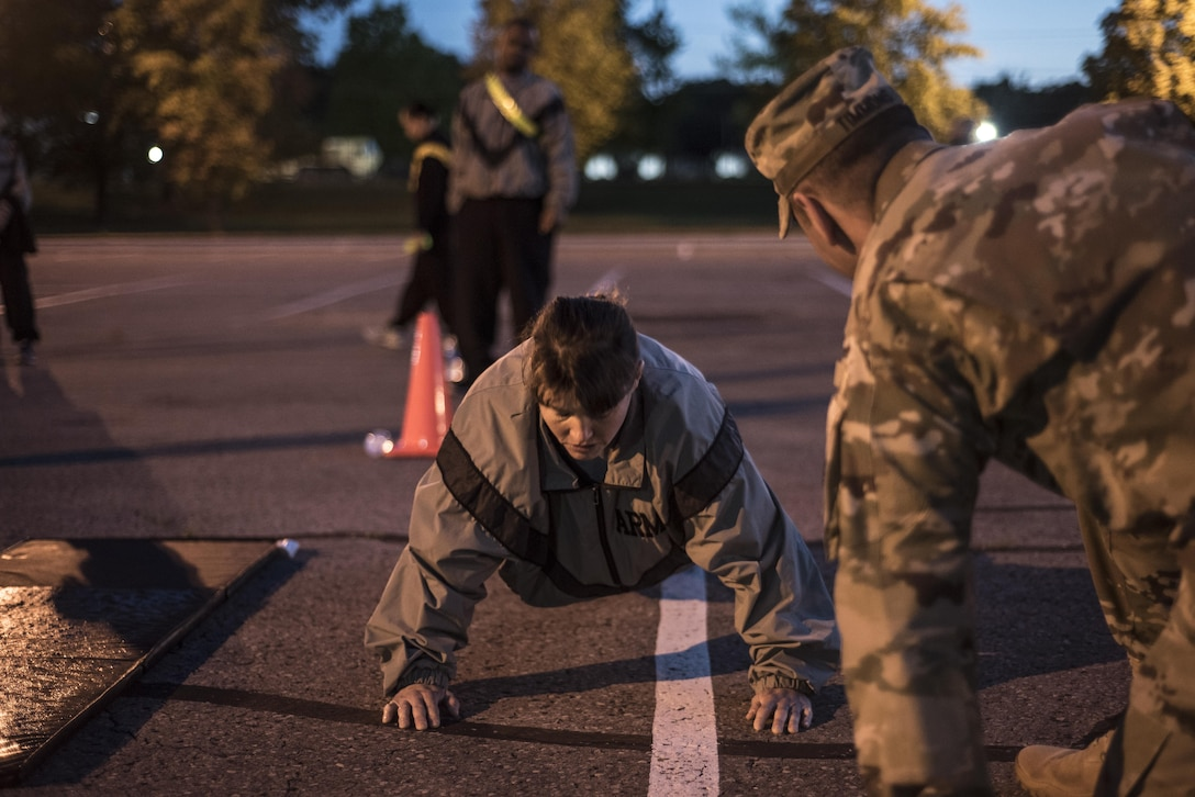 Sgt. Kandy Christian, 2017 U.S. Army Human Resources Command Soldier of the Year, performs push-ups during the HRC Best Warrior Competition held at Fort Knox, Ky., May 8-11, 2017. Christian along with Sgt.1st Class Francis Reyes, 2017 U.S. Army Human Resources Command Noncommissioned Officer of the Year now move on to the Fort Knox Installation competition held on post 21-25 May. (U.S. Army photo by Master Sergeant Brian Hamilton/ released)
