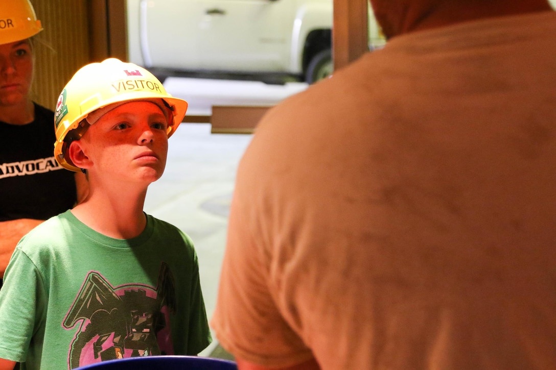 Lydon Swafford (left) listens as he gets a presentation on hydropower at Keystone Dam May 12.  Lydon had won the Mannford Middle School science fair with a project on hydropower and was given a tour of Keystone Dam and powerhouse for his efforts.