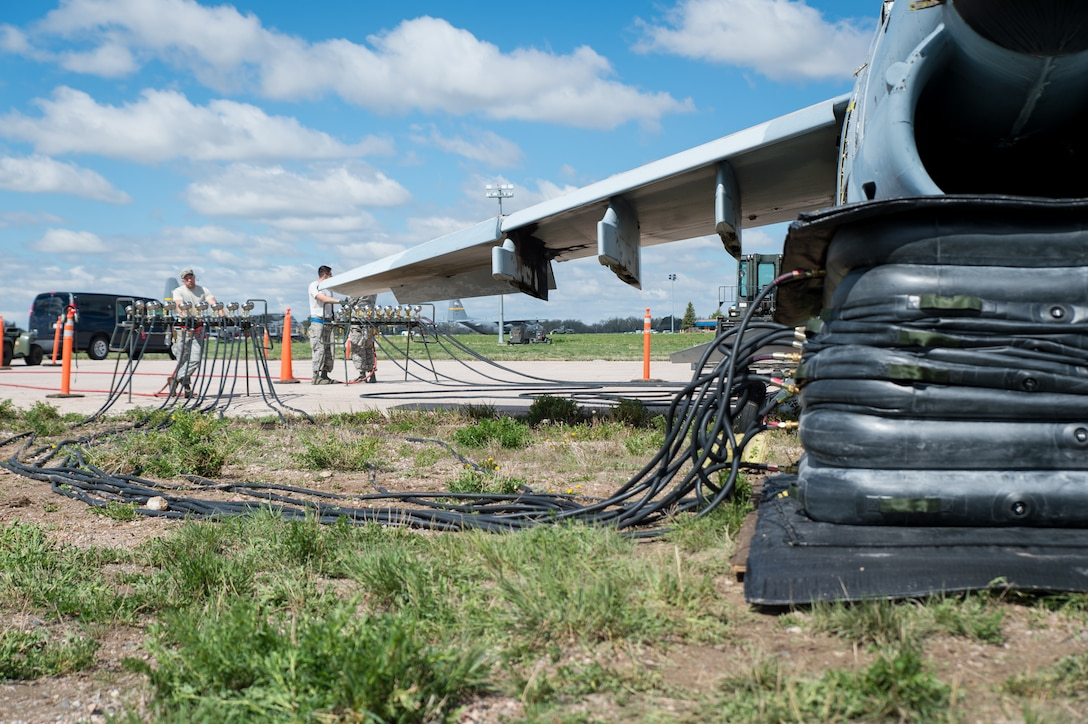 U.S. Air Force Senior Airman Dakota Difrancesco with the 153rd Maintenance Group's Crash Damage or Disabled Aircraft Recovery team monitors a manifold during the jacking of an A-7 Corsair II aircraft, May 11, 2017 in Cheyenne, Wyoming. Maintainers from all aircraft specialties practiced moving a fighter aircraft from the mud into a parking spot as part of an annual CDDAR requirement. (U.S. Air National Guard photo by Senior Master Sgt. Charles Delano/released)