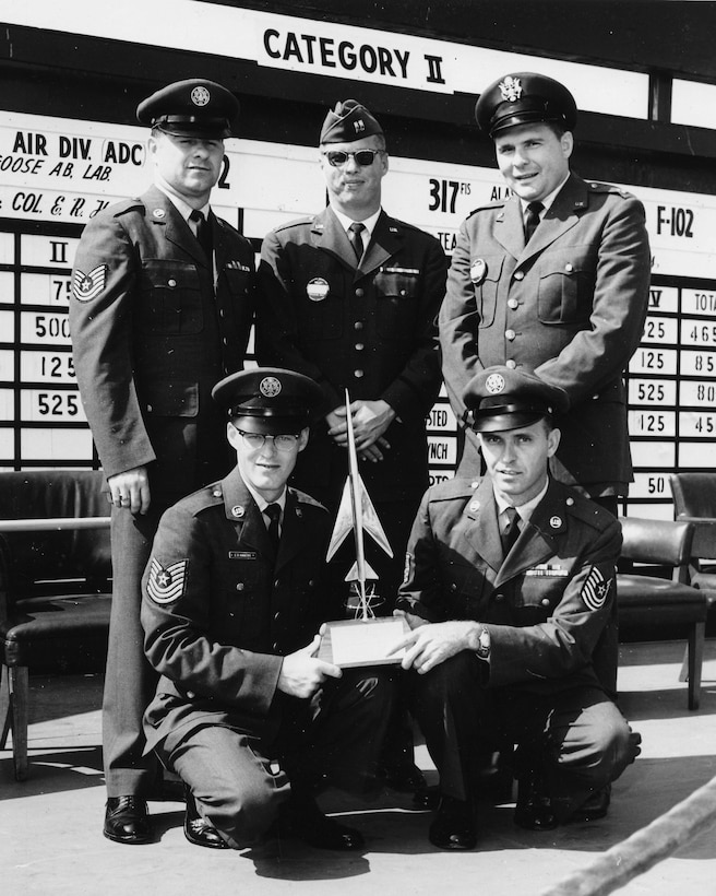 TYNDALL AIR FORCE BASE, Fla. - Capt. Edmund Morrisey, top center, pictured here in 1963 with personnel from the Pennsylvania Air National Guard's 146th Fighter Interceptor Squadron and members of the Colorado and Utah Air National Guard who were among the first Air National Guard teams to win the Air Force's William Tell aerial gunnery competition. (U.S. Air Force file photo/Released)