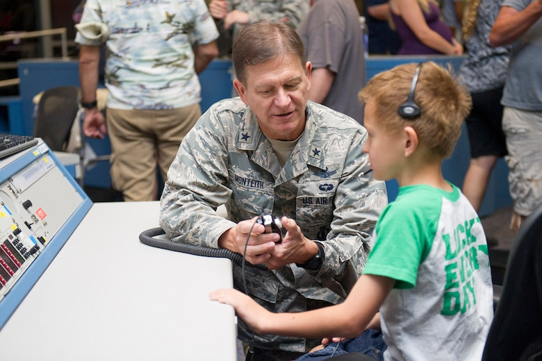 Brig. Gen. Wayne Monteith, 45th Space Wing commander, describes launch operations to a space enthusiasts during the 2017 Cape Family Day April 29, 2017, at Cape Canaveral Air Force Station, Fla. The 45th Space Wing and the Naval Ordnance Test United hosted Cape Family Day to showcase operations for Airmen and their families. More than 2,300 visitors received a rare opportunity and an insider's look at the World's Premier Gateway to Space at the Cape. (U.S. Air Force photo by Phil Sunkel)