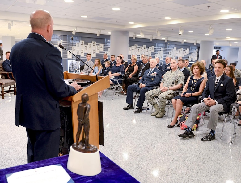 Air Force Vice Chief of Staff Gen. Stephen Wilson talks about the actions taken by Maj. John Hourigan, a 123rd Operations Support Squadron C-130 Hercules pilot,  during the Kolligian Trophy presentation in the Pentagon, Washington, D.C., May 17, 2017. (U.S. Air Force Photo/Andy Morataya)