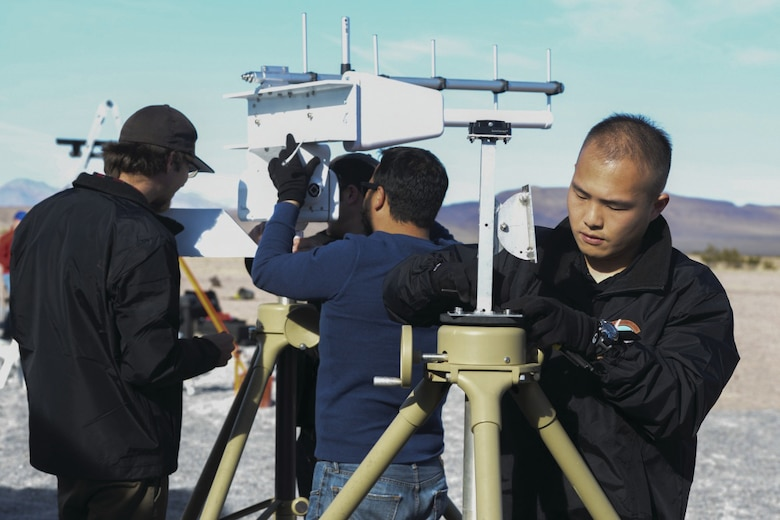 Members of Team Kirtland working to set up radar detection and video tracking equipment during last year's AFRL Commander's Challenge competition Dec. 8-16 in Nevada. Kirtland is hoping to have a team in this year's competition as well.