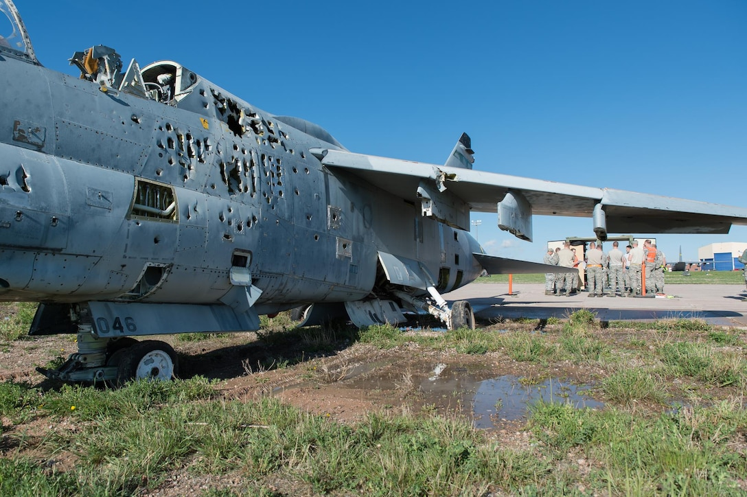 U.S. Air Force Airmen with the 153rd Maintenance Group's Crash Damage or Disabled Aircraft Recovery team conduct a safety briefing prior to jacking an A-7 Corsair II aircraft, May 11, 2017 in Cheyenne, Wyoming. Maintainers from all aircraft specialties practiced moving a fighter aircraft from the mud into a parking spot as part of an annual CDDAR requirement. (U.S. Air National Guard photo by Senior Master Sgt. Charles Delano/released)