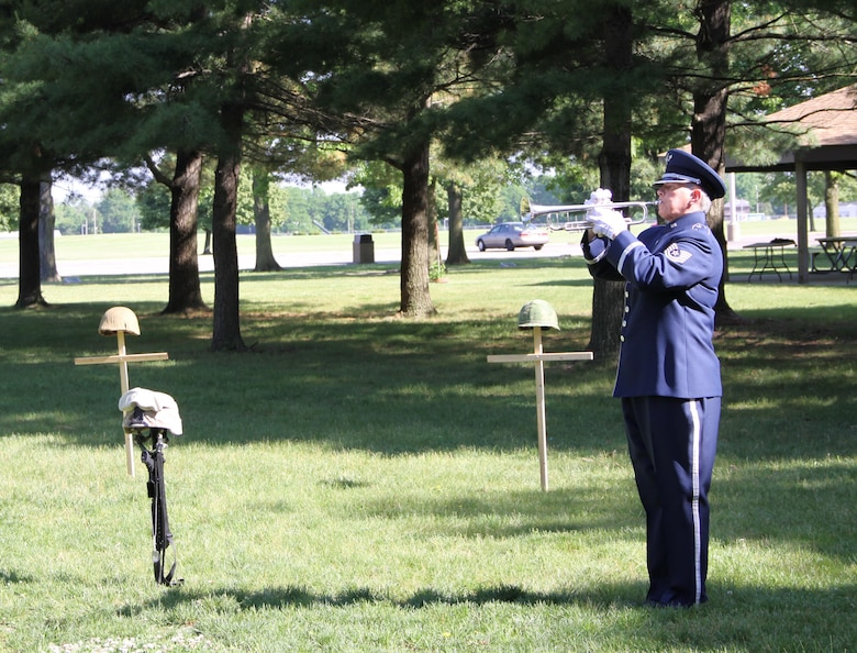 Taps was played May 26, 2016, by bugler Tech. Sgt. Cheryl Przytula, Air Force Band of Flight, during the 2016 Roll Call Memorial Service in the outdoor Memorial Park at the National Museum of the U.S. Air Force, Wright-Patterson Air Force Base. This year's ceremony falls on May 24 at 9 a.m. and is open to the public. (U.S. Air Force photo/Ted Pitts)
