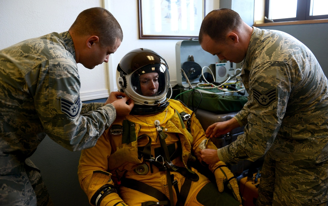 9th Physiological Support Squadron launch and recovery technicians, conduct a pre-flight inspection on a full-pressure suit at Joint Base Elmendorf-Richardson, Alaska, May 8, 2017. The U-2 Dragon Lady participated for the first time in exercise Northern Edge, which is a joint exercise that involves over 200 fixed-wing aircraft. (U.S. Air Force photo/Staff Sgt. Jeffrey Schultze)