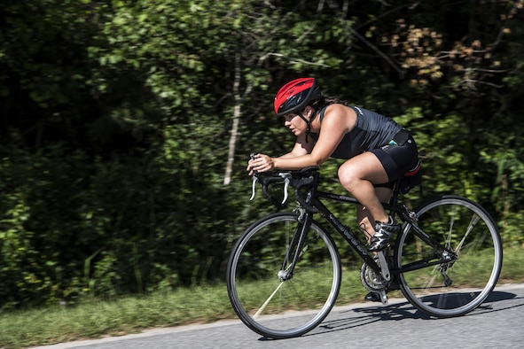 A competitor coasts through the bike portion of the Police Week Quadathalon, May 15, 2017, at Moody Air Force Base, Ga. Teams of four participated in a swim, run, bike and ruck march competition, where the team with the fastest time won bragging rights. Overall, Police Week is designed to honor the legacies fallen officers, both civilian and military, have left behind, but it also gives various sections within the law enforcement community an opportunity to train together in friendly competitions. (U.S. Air Force photo by Senior Airman Janiqua P. Robinson)