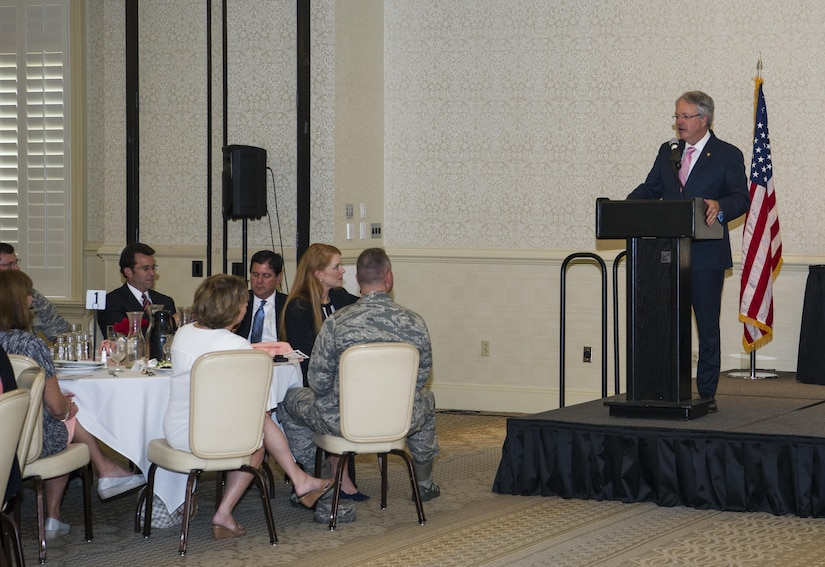 Charleston Mayor John Tecklenburg speaks at the Federal Executive Association's Annual Federal Employee of the Year Luncheon at Joint Base Charleston, S.C., May 12, 2017. The event recognizes federal employees who go above and beyond their normal duties. The FEA promotes coordination between federal agency programs for maximum public benefit and fosters stronger relationships between the agencies' management officials.