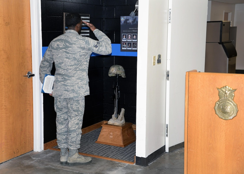 The 82nd Security Forces Squadron held a ceremony at Sheppard Air Force Base, Texas, May 17, 2017, which honored defenders who have made the ultimate sacrifice serving their country. Senior Airman Earnest Jackson Jr., 82nd SFS combat arms instructor, salutes the battlefield cross, which holds the dog tags of fallen defenders. (U.S. Air Force photo by Senior Airman Robert L. McIlrath)