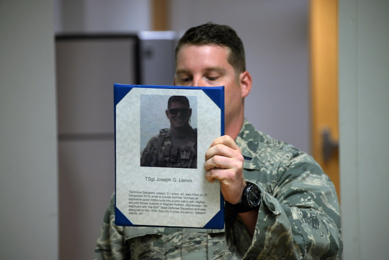 The 82nd Security Forces Squadron held a ceremony at Sheppard Air Force Base, Texas, May 17, 2017, which honored defenders who have made the ultimate sacrifice serving their country. 1st Lt. Bryan Duggan, 82nd SFS operations officer, holds up a picture of Tech. Sgt. Joseph Lemm, a fellow defender who was killed on Dec. 21, 2015, by a suicide bomber. Lemm was assigned to the 105th SFS at Stewart Air National Guard Base, New York. (U.S. Air Force photo by Senior Airman Robert L. McIlrath)