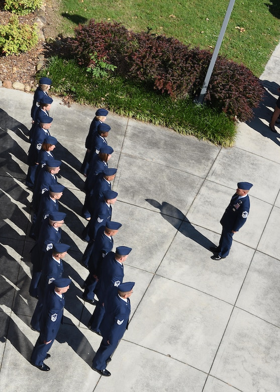 Faculty and staff assigned to the Air National Guard's I.G. Brown Training and Education Center in East Tennessee formed ranks during a retreat ceremony with others at the Class 17-4 NCO Academy graduation May 16, 2017. Military retreat ceremonies pay respect to the Flag when it is lowered at the end of a duty day and can include group formation, bugle call, salute and flag folding, among other traditions. TEC service members recite the Airman's Creed at the end of their flag ceremonies. TEC includes the Air Force's largest enlisted professional military education center, which educates thousands of active duty, National Guard, Reserve Command and international students every year. (U.S. Air National Guard photo by Master Sgt. Mike R. Smith)