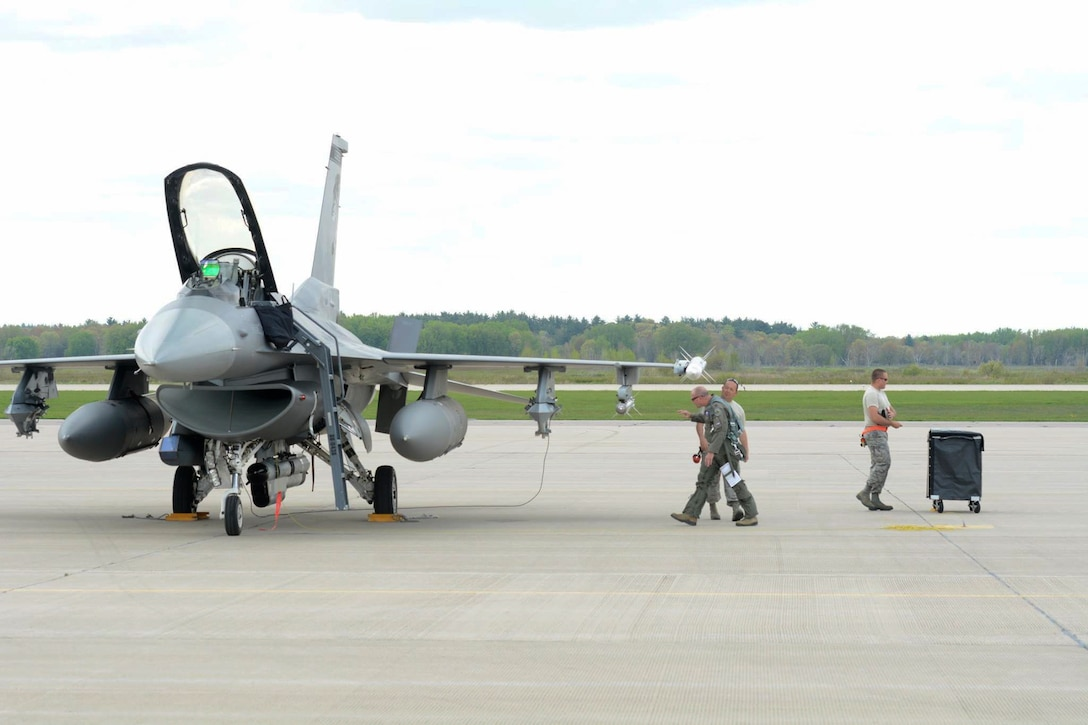 Lt. Col. Todd Sheridan, 175th Fighter Squadron pilot, performs a walk around inspection during Exercise Northern Lightning at Volk Field Combat Readiness Training Center, Camp Douglas, Wisconsin, May 1-12, 2017. Northern Lightning is an exercise involving around 1,500 service members from the Air Force, Navy, Marines and National Guard across the country. (U.S. Air National Guard photo by Staff Sgt. Andrea F. Rhode/Released)