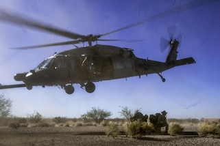 An HH-60 Pave Hawk drops off pararescuemen during a personnel recovery scenario as part of Angel Thunder 17 in Gila Bend, Ariz., May 13, 2017. Angel Thunder is a two-week, Air Combat Command-sponsored exercise focused on search and rescue capabilities. Air Force photo by Staff Sgt. Marianique Santos