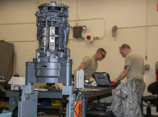 A M61A1 20mm Gatling Gun sits on a stand while U.S. Air Force Senior Airman Joshua Wood and Airman 1st Class John Williams, both 35th Maintenance Squadron armament technicians, work on breach bolts at Kunsan Air Base, Republic of Korea, May 15, 2017. Breach bolts pulls the round into the rotor, pulling it forward so it can fire then pulls it back. This was a part of an 18-month inspection where they completely break down the M61A1 20mm Gatling Gun and rebuild it, repairing or replacing any components that have been damaged.