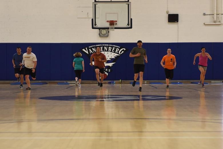 Team V members perform exercise drills called suicides during a functional fitness class, May 15, 2017, Vandenberg Air Force Base, Calif. Physical Fitness Month encourages a renewed commitment to a healthy, active lifestyle. (U.S. Air Force photo by Senior Airman Robert J. Volio/Released)