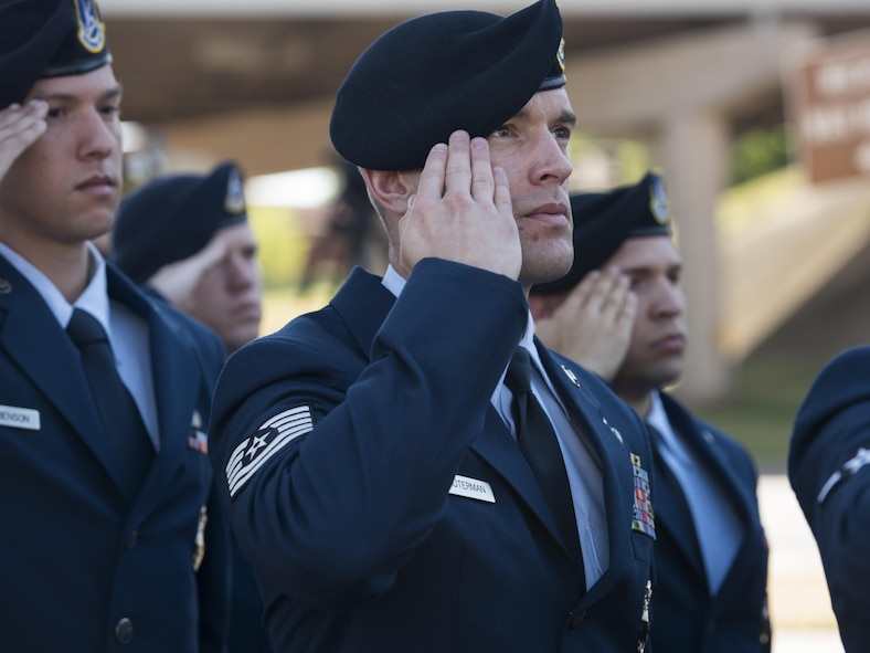 Tech. Sgt. Jered Dauterman, 82nd Security Forces Squadron NCO in charge of training, salutes the U.S. flag as it rises to half-staff during the National Police Week proclamation ceremony, May 15, 2017. National Police Week honors both current and former law enforcement officers as well as officers who've paid the ultimate sacrifice. (U.S. Air Force photo by Staff Sgt. Kyle E. Gese)