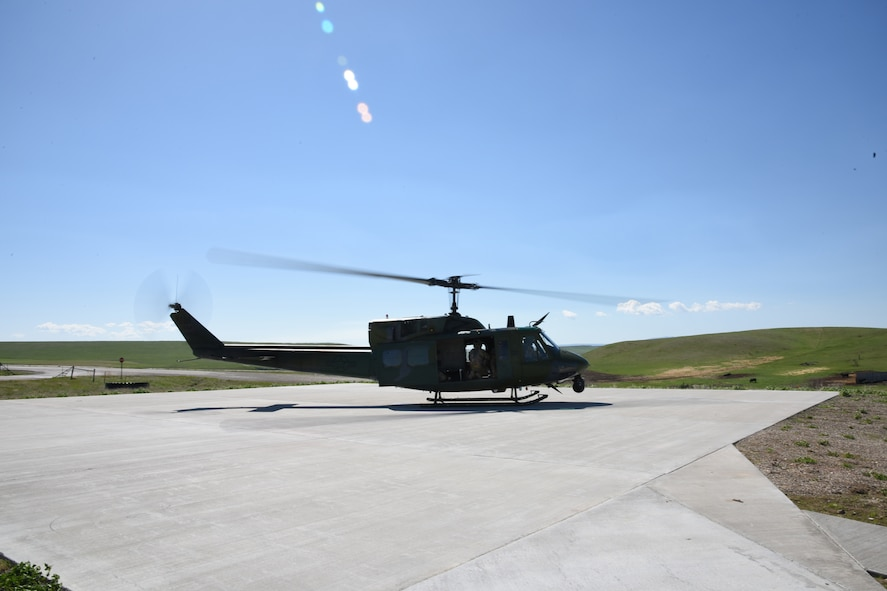 A UH-1N Helicopter from the 40th Helicopter Squadron prepares to take off from a refueling helicopter pad at a missile alert facility May 11, 2017, at Malmstrom Air Force Base, Mont. New helicopter pads and refueling units were recently installed to seven out of 15 MAFs to provide rapid helicopter refueling. (U.S. Air Force photo/ Staff Sgt. Delia Marchick)