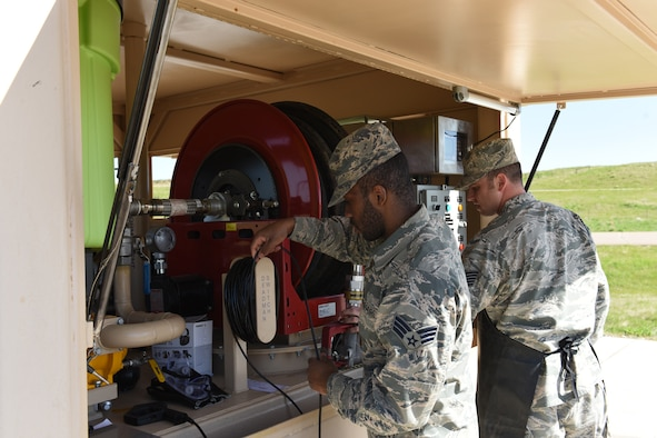 Tech Sgt. Nathan Wiley, 10th Missile Squadron facility manager, right, and Senior Airman Bryan Williams, 341st Force Support Squadron missile chef, run through a pre-operation checklist in preparation for a helicopter refuel at a missile alert facility May 11, 2017, at Malmstrom Air Force Base, Mont. Some of the items on the checklist require a second person, so the facility manager will get assistance from either the missile chef or an available security forces member. (U.S. Air Force photo/ Staff Sgt. Delia Marchick)