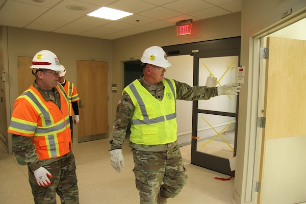 Health Facility Planning Officer Lt. Col. John Smith (right), with the U.S. Army Health Facility Planning Agency shows  U.S. Army Corps of Engineers Deputy Commanding General for Military and International Operations Maj. Gen. Mark Yenter(left) a triage room located within the hospital's emergency department as they toured the new Fort Irwin Weed Army Community Hospital project  at Fort Irwin, California, during a visit here May 15.