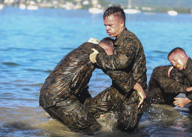 MARINE CORPS BASE HAWAII – Marines attached to the 11th Marine Expeditionary Unit participate in shallow water grappling during a Martial Arts Instructors Course aboard Marine Corps Base Hawaii on May 1, 2017. The MAIC is a three week long course that puts students through various training to include paper test, physical training and evaluations on properly teaching techniques. The Makin Island Amphibious Ready Group/11th MEU is currently underway on their Western Pacific 16-2 deployment. (U.S. Marine Corps photo by Cpl. Zachary Orr)