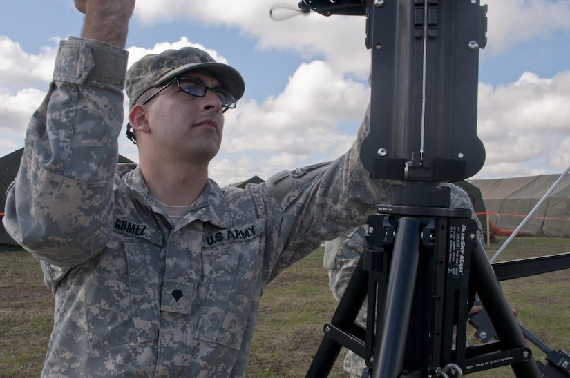 Army Spc. Cody Gomez, a microwave system operator maintainer for the Army Reserve's 306th Psychological Operations Company, assembles a transmission antenna during Exercise Maple Resolve 17 at Camp Wainwright, Alberta, May 16, 2017. Exercise Maple Resolve is an annual collective training event designed for any contingency operation. About 4,000 Canadian and 1,000 U.S. troops participated. Army photo by Staff Sgt. Michael Crawford