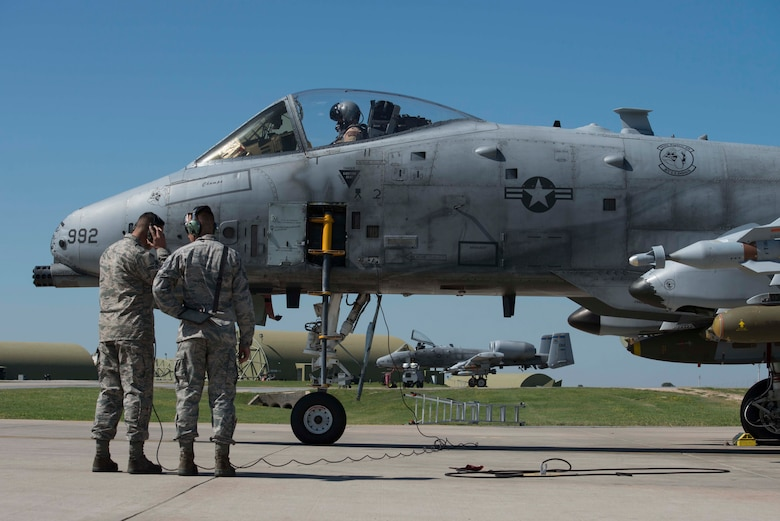 U.S. Senior Airman Justin Macken (left), and Staff Sgt. Alex Albrecht, crew chiefs with the 447th Expeditionary Aircraft Maintenance Squadron, speak with the A-10 Thunderbolt II pilot during a pre-flight check April 5, 2017, at Incirlik Air Base, Turkey, in support of Operation INHERENT RESOLVE. Pre-flight checks are accomplished to ensure the aircraft is prepared for flight. (U.S. Air Force photo by Airman 1st Class Devin M. Rumbaugh)