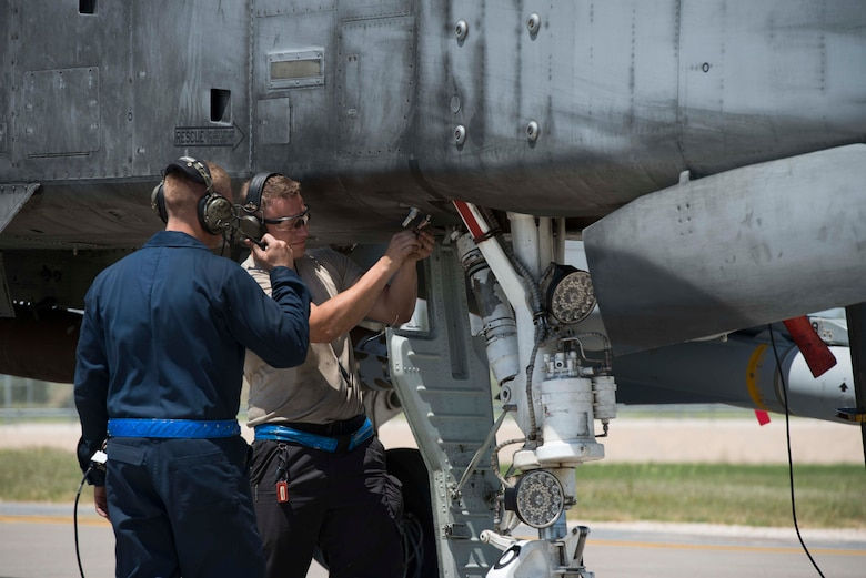 U.S. Air Force Staff Sgt. Nicholas Reider (left), and Staff Sgt. William Flores, crew chiefs with the 447th Expeditionary Aircraft Maintenance Squadron, check the landing gear of an A-10 Thunderbolt II May 11, 2017, at Incirlik Air Base, Turkey, in support of Operation INHERENT RESOLVE. Crew chiefs are responsible for launching, recovering and maintaining aircraft. (U.S. Air Force photo by Airman 1st Class Devin M. Rumbaugh)