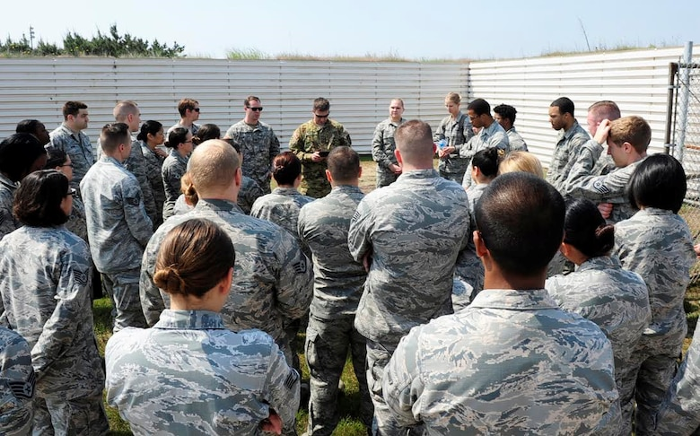 Soldiers from Charlie Company, 3-2 General Support Aviation Battalion brief 8th Medical Group Airmen on emergency medical evacuation procedures at Kunsan Air Base, Republic of Korea, May 17, 2017. The purpose of the training was aimed to train medics on loading patients onto a helicopter for dust-off. (U.S. Air Force photo/Staff Sgt. Chelsea Sweatt)
