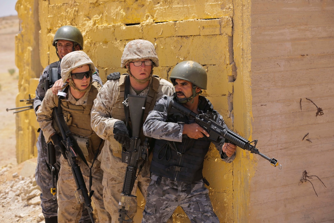 U.S. Marines with Military Police Company Alpha, 4th Law Enforcement Battalion, and the Jordanian 77th Marine Battalion, participate in a Non-Lethal Weapons and Tactics Course during Eager Lion 17, May 11, 2017. Eager Lion is an annual U.S. Central Command exercise in Jordan designed to strengthen military-to-military relationships between the U.S., Jordan and other international partners. This year's iteration is comprised of about 7,400 military personnel from more than 20 nations that will respond to scenarios involving border security, command and control, cyber defense and battlespace management.  (U.S. Marine Corps photo by Staff Sgt. Vitaliy Rusavskiy/Released)