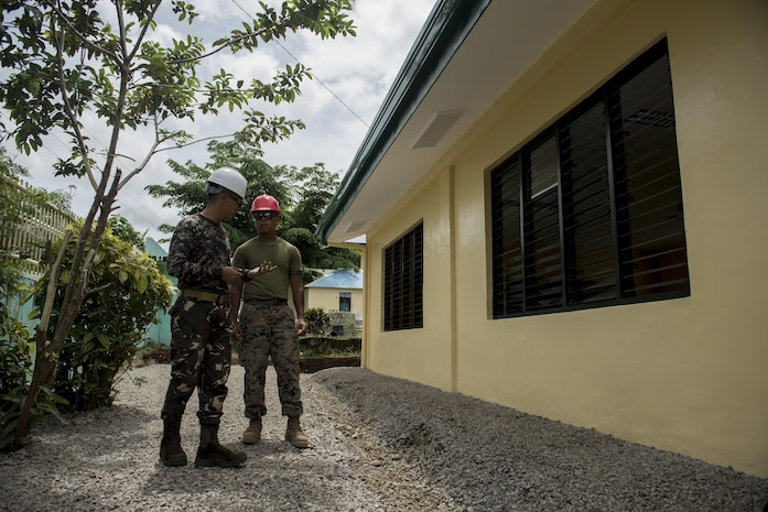 Philippine Army Capt. Armando Moncayo, Jr., left, and U.S. Marine Sgt. Lance Escobar discuss construction progress during an engineering civic assistance project in support of Balikatan 2017 in Ormoc City, Leyte, May 14, 2017. Philippine and U.S. service members worked together to build new classrooms for students at Don Carlos Elementary School. Balikatan is an annual U.S.-Philippine bilateral military exercise focused on a variety of missions, including humanitarian assistance and disaster relief, counterterrorism, and other combined military operations.
