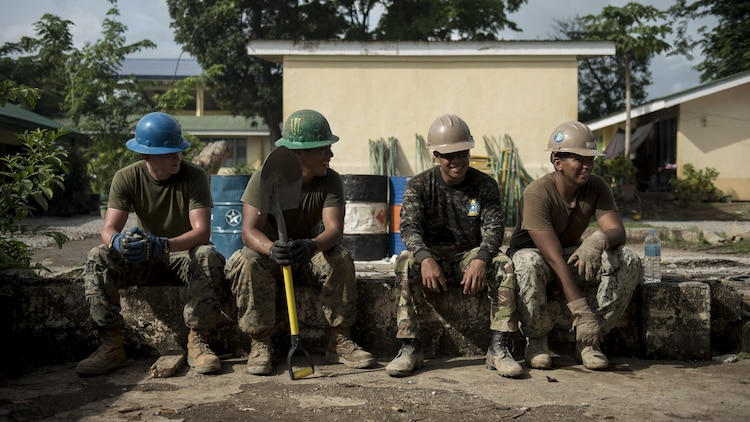 Philippine Army and U.S. Marine engineers take a break during an engineering civic assistance project in support of Balikatan 2017 in Ormoc City, Leyte, May 14, 2017. Philippine and U.S. service members worked together to build new classrooms for students at Don Carlos Elementary School. Balikatan is an annual U.S.-Philippine bilateral military exercise focused on a variety of missions, including humanitarian assistance and disaster relief, counterterrorism, and other combined military operations.