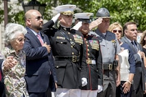 The guests of honor and reviewing officials render honors to the national flag and the Marine Corps Battle Colors during a Battle Color Ceremony at the Ohio Statehouse, Columbus, Ohio, May 16, 2017. The Marine Corps Battle Color Detachment was invited and hosted by the Speaker of the Ohio House of Representatives, Clifford A. Rosenberger, to tour the Statehouse and perform for members of the House of Representatives and the city of Columbus. In December, the Barracks provided Marines in supporting the public viewing of former Marine, Senator and astronaut, John Glenn, at the Statehouse. In attendance at the Battle Color Ceremony was Glenn's widow, Annie Glenn, to show her continued support of the beloved Corps. (Official Marine Corps photo by Cpl. Robert Knapp/Released)