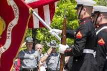 Ohio State Highway Patrolmen render honors to the national flag and the Marine Corps Battle Colors during a Battle Color Ceremony at the Ohio Statehouse, Columbus, Ohio, May 16, 2017. The Marine Corps Battle Color Detachment was invited and hosted by the Speaker of the Ohio House of Representatives, Clifford A. Rosenberger, to tour the Statehouse and perform for members of the House of Representatives and the city of Columbus. In December, the Barracks provided Marines in supporting the public viewing of former Marine, Senator and astronaut, John Glenn, at the Statehouse. In attendance at the Battle Color Ceremony was Glenn's widow, Annie Glenn, to show her continued support of the beloved Corps. (Official Marine Corps photo by Cpl. Robert Knapp/Released)