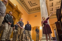 Dayna Jalkanen, deputy director of museum and education, Ohio Statehouse, explains the significance of the Senate Chambers to U.S. Marine Drum & Bugle Corps Marines at the Statehouse, Columbus, Ohio, May 15, 2017. The Marine Corps Battle Color Detachment was invited and hosted by the Speaker of the Ohio House of Representatives, Clifford A. Rosenberger, to tour the Statehouse and perform for members of the House of Representatives and the city of Columbus. In December, the Barracks provided Marines in supporting the public viewing of former Marine, Senator and astronaut, John Glenn, at the Statehouse. In attendance at the Battle Color Ceremony was Glenn's widow, Annie Glenn, to show her continued support of the beloved Corps. (Official Marine Corps photo by Cpl. Robert Knapp/Released)