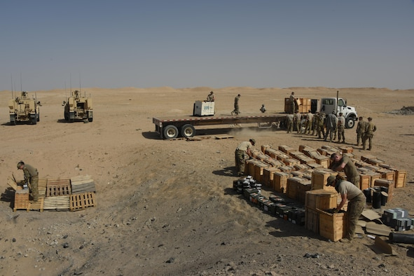 A group of explosive ordnance disposal technicians, ammunition personnel and firefighters from the 386th Air Expeditionary Wing work together to dispose of a truckload of unserviceable ordnances in a safe manner at an undisclosed location in Southwest Asia May 11, 2017. The stockpile of expired munitions consisting primarily of flares was transported to an isolated location where the unserviceable items were stacked in a man-made hole in preparation for destruction. (U.S. Air Force photo/Tech. Sgt. Jonathan Hehnly)