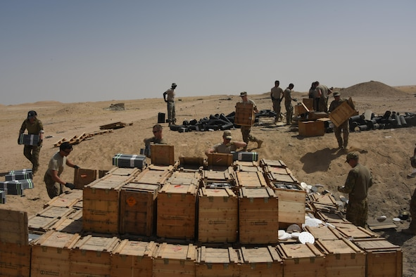 A group of explosive ordnance disposal technicians, ammunition personnel and firefighters from the 386th Air Expeditionary Wing work together to dispose of a truckload of ordnances in a safe manner at an undisclosed location in Southwest Asia May 11, 2017. The stockpile of expired munitions consisting primarily of flares was transported to an isolated location where the unserviceable items were stacked in a man-made hole in preparation for destruction. (U.S. Air Force photo/Tech. Sgt. Jonathan Hehnly)