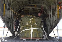 Citizen Airmen with the 920th Rescue Wing secure a pallet of search and rescue equipment inside an HC-130 King aircraft May 16 at Patrick Air Force Base, Florida, in preparation for a mission off the coast of the Bahamas to search for a downed aircraft and four passengers. (U.S. Air Force photo/Senior Airman Brandon Kalloo)