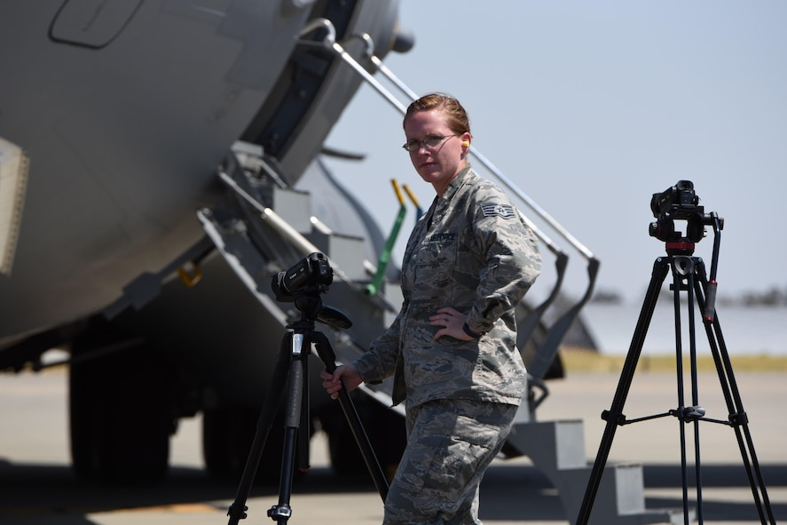 Staff Sgt. Jessica Keys, 367th Training Support Squadron, configures her camera equipment to capture video of a C-17 Globemaster at Travis Air Force Base, California, for a Foreign Object Damage and Dropped Object Prevention Program (FOD/DOPP) training video. (U.S. Air Force/Tech. Sgt. Rudy Gonzales)