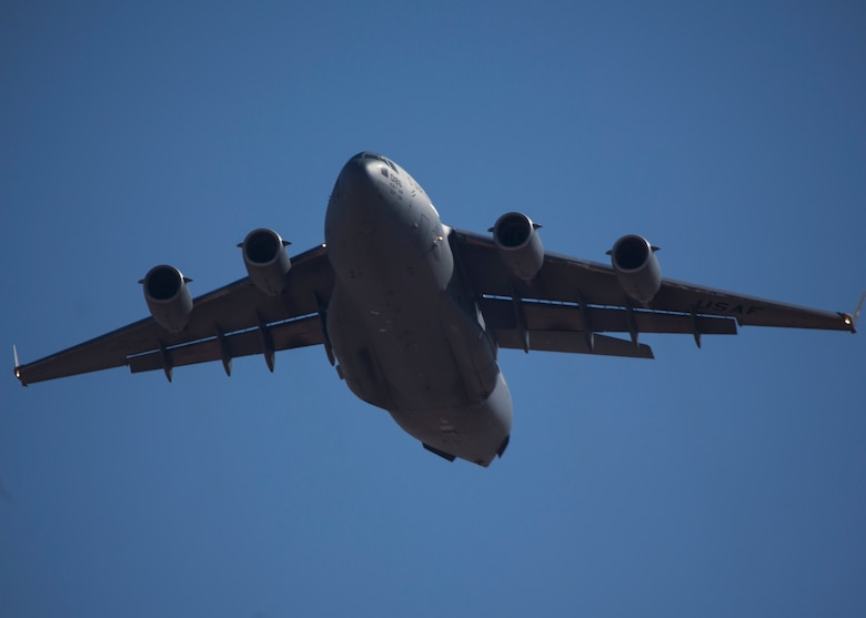 A U.S. Air Force C-17 Globemaster III from the 3d Airlift Squadron conducts low approaches with a Marine Air Traffic Control Mobile Team (MMT)in support of Weapons and Tactics Instructors Course (WTI) 2-17 at Auxiliary Airfield II, Yuma, Ariz., April 19, 2017. WTI is a seven-week training event hosted by MAWTS-1 cadre, which emphasizes operational integration of the six functions of Marine Corps aviation in support of a Marine Air Ground Task Force and provides standardized advanced tactical training and certification of a unit instructor qualifications to support Marine Aviation Training and Readiness and assist in developing and employing aviation weapons and tactics (U.S Marine Corps photo by Lance Cpl. Luis Quinones)