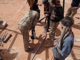 Members of Maghawir al-Thawra work to repair a water well in At Tanf Garrison in southern Syria for partner forces fighting the Islamic State of Iraq and Syria and local residents in the area. The water well is capable of supplying more than 317,000 gallons of water daily. Army photo