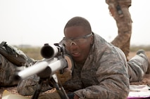 Staff Sgt. Julius Taylor, assigned to Ramstein Airbase, 435th Security Forces Squadron, participates in a range estimation qualification test at Dona Ana Range Complex April 25, 2017. Taylor is training to become an air force sharpshooter at the Desert Defender Ground Readiness Combat Training Center in Fort Bliss, Texas. (Air National Gaurd Photo by Staff Sgt. Agustin G. Salazar)