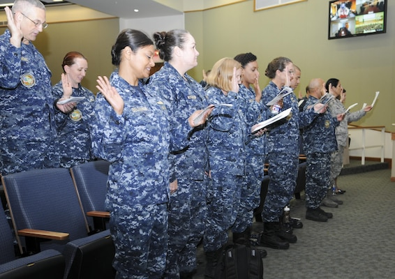 Nurses and medical technicians recite the Florence Nightingale Pledge during the closing ceremony for National Nurses Week at the Medical Education and Training Campus at Joint Base San Antonio-Fort Sam Houston May 11. Navy and Air Force nurses and medical technicians participated together in several health promotions activities throughout the week to commemorate Nurses Week.