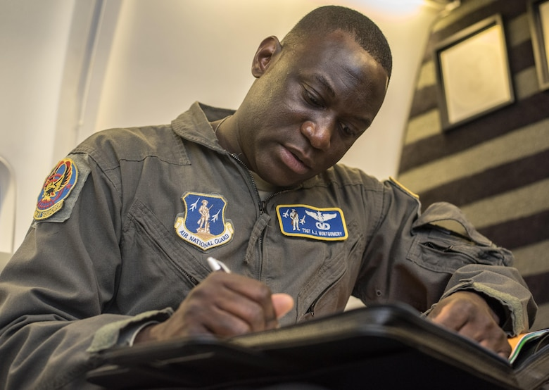 Tech. Sgt. Anthony Montgomery, 201st Airlift Squadron flight attendant, takes pre-flight notes before a Mission Readiness Airlift at Joint Base Andrews, Md., March 31, 2017. The 201st AS supports a flying schedule consisting of approximately five large trips a month that range from five to 12 days and go almost anywhere around the world. (U.S. Air Force photo by Senior Airman Jordyn Fetter)